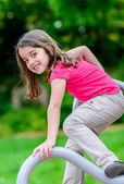 Pretty little girl on a playground — Stock Photo