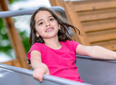 Happy pretty little girl in playground — Stock Photo