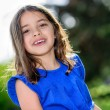 Stock Photo: Portrait of a happy pretty little girl