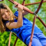 Pretty girl doing rock climbing — Stock Photo #26471899