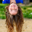 Beautiful child hanging upside - Stock Photo