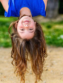 Beautiful child hanging upside — Stock Photo