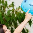 Stock Photo: Portrait of very happy cute child playing with blue balloon