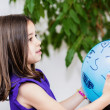 Stock Photo: Portrait of pretty young girl child playing with blue balloon