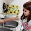 Expressive portrait of very cute girl washing hands — Stok fotoğraf