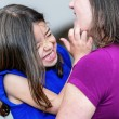Stock Photo: Complicity between very cute little girl and her mother