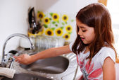 Expressive portrait of very cute girl washing hands — Stock Photo