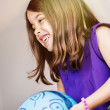 Stock Photo: Portrait of very cute girl playing with blue balloon