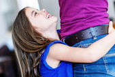 Pretty girl close against her mother with complicity — Stock Photo