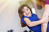 Complicity between a very cute little girl and her mother — Stock Photo