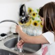 Expressive portrait of very cute girl washing hands — Foto Stock