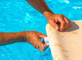 Clean the water line of a pool — Stock Photo