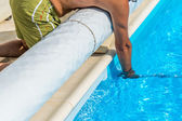 Connecting the suction hose to the pool — Stock Photo