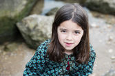 Natural portrait of cute child with rocks in the background — Photo