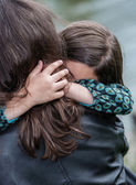 Expressive portrait of pretty girl hugging her mother — Photo