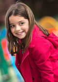 Beautiful portrait of pretty girl in a yard for child — Stock Photo