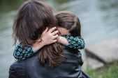Expressive portrait of pretty girl hugging her mother — Stockfoto