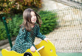 Beautiful portrait of pretty girl on a merry for child — Stock Photo