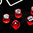Closeup of red dices to play casino or gambling money — Stock Photo #35122841