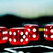 Closeup of red dices to play casino or gambling money — Stock Photo #35122915