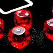 Closeup of red dices to play casino or gambling money — Stock Photo #35122923