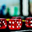Closeup of red dices to play casino or gambling money — Stock Photo #35123359