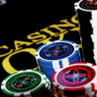 Poker Chips on a gaming table — Stock Photo