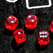 Closeup of red dices to play casino or gambling money — Stock Photo