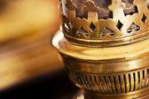 Old kerosene lamp next to an old mirror — Stock Photo
