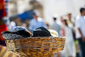 Fedora and panama hats for sale in oriental market — Stock Photo