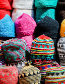 Colorful wool caps for sale in oriental market — Stock Photo