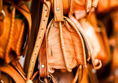 Leather bags on stall on the street market in Morocco — Stock Photo
