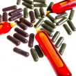 Stock Photo: Close up of vitamin ampuls and natural pills