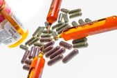 Close up of vitamin ampuls and natural pills — Stock Photo