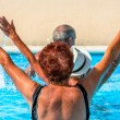 Active seniors getting workout at swimming pool — Stock Photo #36699897