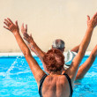 Active seniors getting workout at swimming pool — Stock Photo #36700005