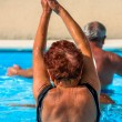 Active seniors getting workout at swimming pool — Stock Photo #36700193