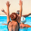 Active seniors getting workout at swimming pool — Stock Photo #36700529