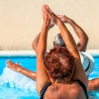 Active seniors getting workout at swimming pool — Stock Photo #36700827