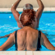 Active seniors getting workout at swimming pool — Stock Photo #36700845