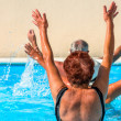 Active seniors getting workout at swimming pool — Stock Photo #36701149