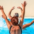 Active seniors getting workout at swimming pool — Stock Photo #36701303