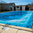 Pool protected by a pool cover during winter months — Stock Photo #36701977