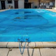 Pool protected by a pool cover during winter months — Stock Photo #36702201