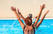 Active seniors getting a workout at the swimming pool — Foto de Stock