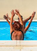 Active seniors getting a workout at the swimming pool — Stockfoto