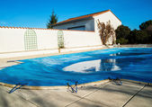 Pool protected by a pool cover during winter months — Stockfoto