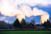 A nuclear power plant located in the countryside close to homes — Stock Photo