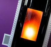 Closeup on the combustion of an pellet stove — Stock Photo