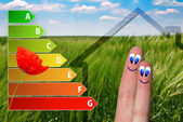 Icon of house energy efficiency rating with cute fingers, poppy and green background — Stockfoto